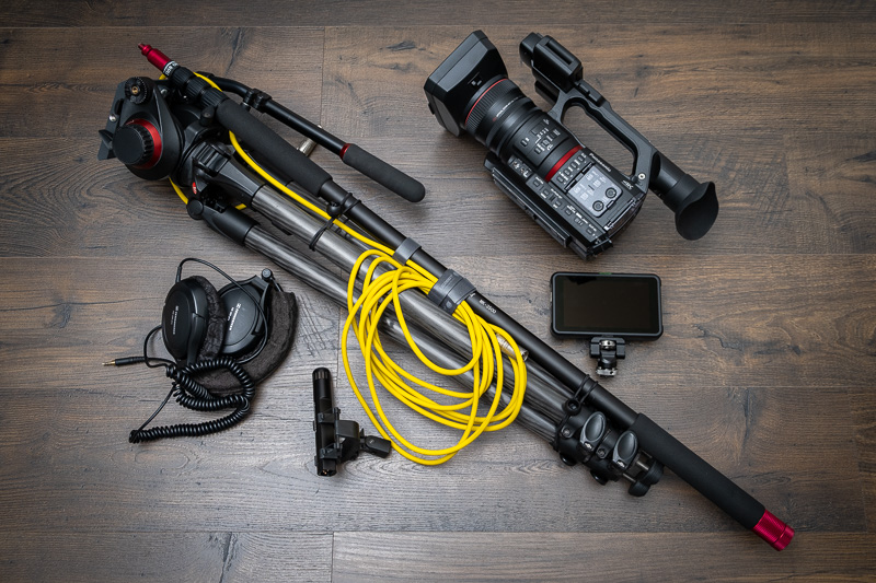 A video camera, tripod, microphone and other filming equipment.